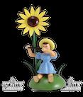 Blumenkind sitz. mit Sonnenblume/Querflöte