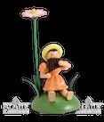 Blumenkind sitz. mit Gänseblümchen/Panflöte